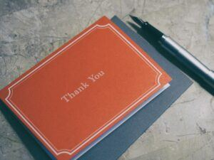 fountain-pen-next-to-red-Thank-You-journal