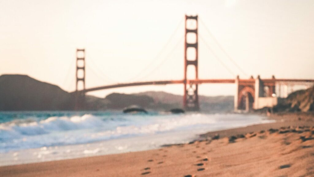 footprints-on-sand-near-Golden-Gate-Bridge