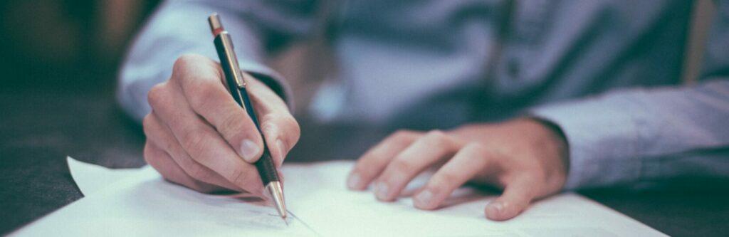 man-writing-on-paper