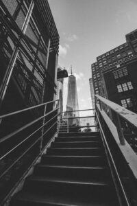 grayscale-photography-of-stairway-leading-to-building
