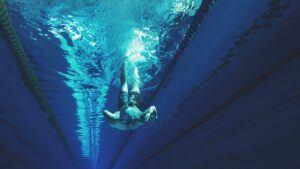 man-swimming-in-swimming-pool