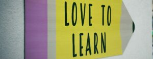 love-to-learn-pencil-signage-on-wall