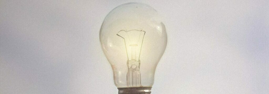 person-catching-light-bulb