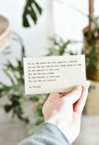 person-holding-quote-card