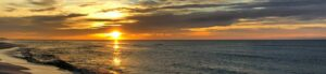 calm-sea-and-shore-during-golden-hour